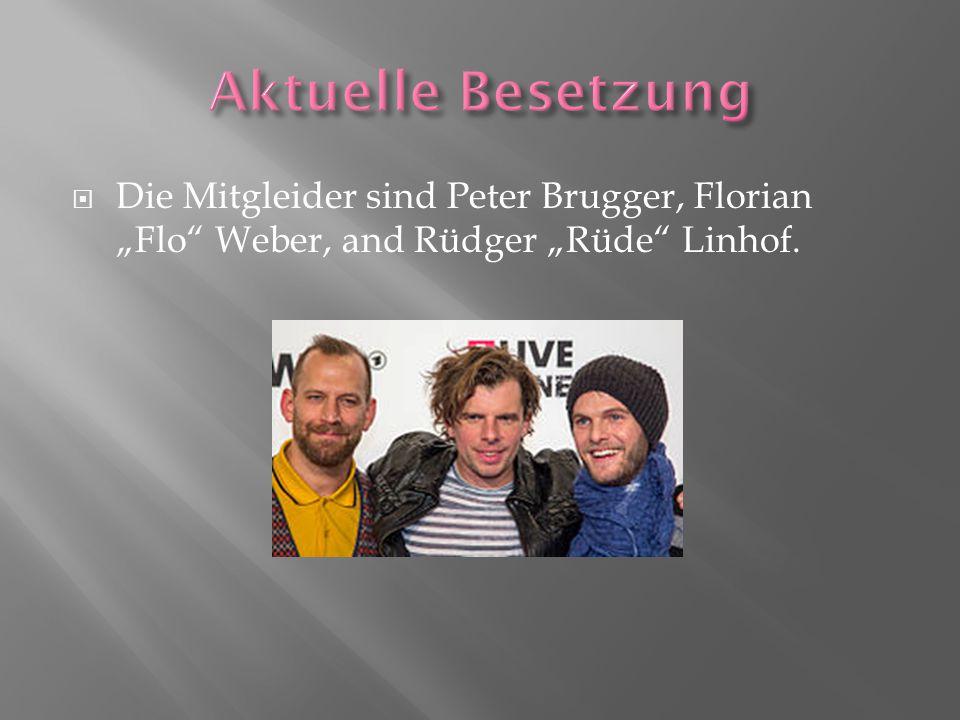 " Die Mitgleider sind Peter Brugger, Florian ""Flo"" Weber, and Rüdger ""Rüde"" Linhof."