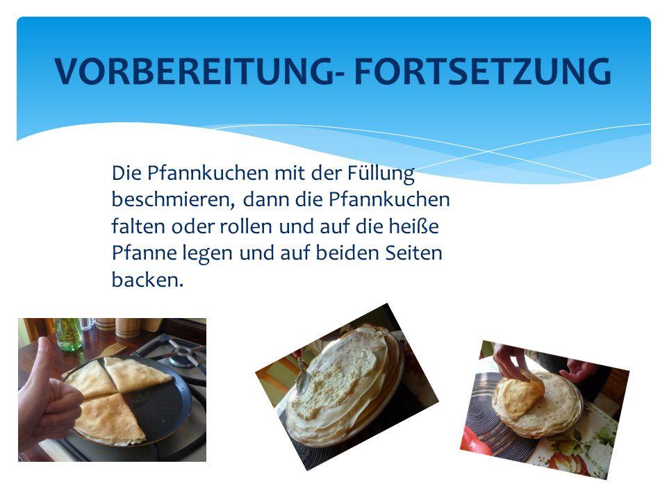 Die Pfannkuchen mit der Füllung beschmieren, dann die Pfannkuchen falten oder rollen und auf die heiße Pfanne legen und auf beiden Seiten backen.