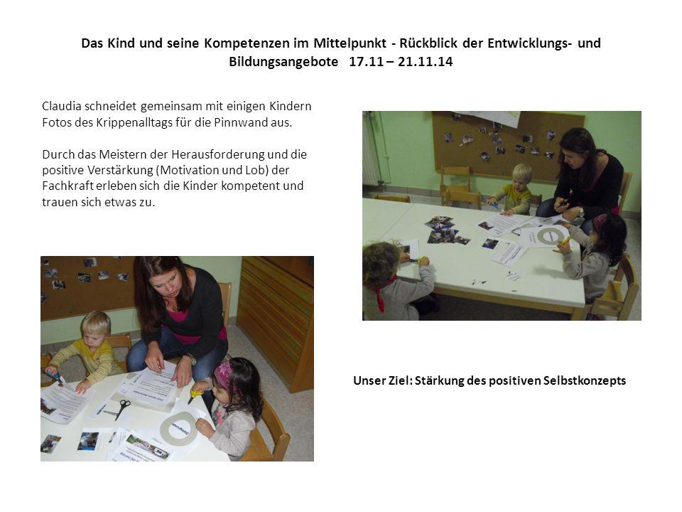Das Kind und seine Kompetenzen im Mittelpunkt - Rückblick der Entwicklungs- und Bildungsangebote 17.11 – 21.11.14 Claudia schneidet gemeinsam mit einigen Kindern Fotos des Krippenalltags für die Pinnwand aus.
