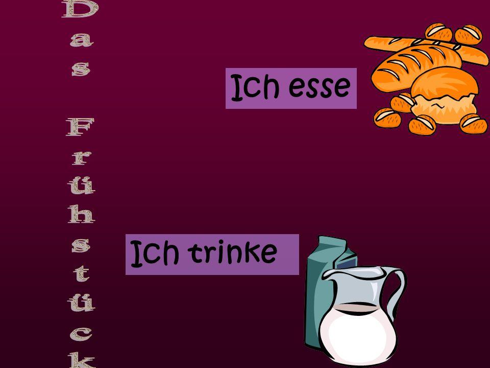 ein gekochtes Eiein Spiegelei Brot ein Brötchen MarmeladeButterCornflakes Tee Milch heiße SchokoladeOrangensaft