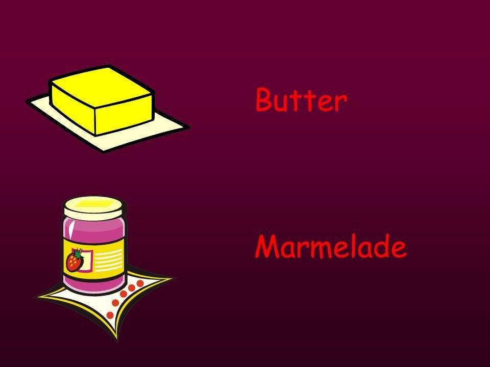 ein gekochtes Ei Brot ein Brötchen MarmeladeButterCornflakes Tee Milch heiße SchokoladeKaffeeOrangensaft