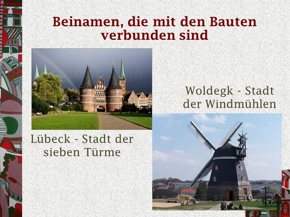 Beinamen, die mit den Bauten verbunden sind Lübeck - Stadt der sieben Türme Woldegk - Stadt der Windmühlen