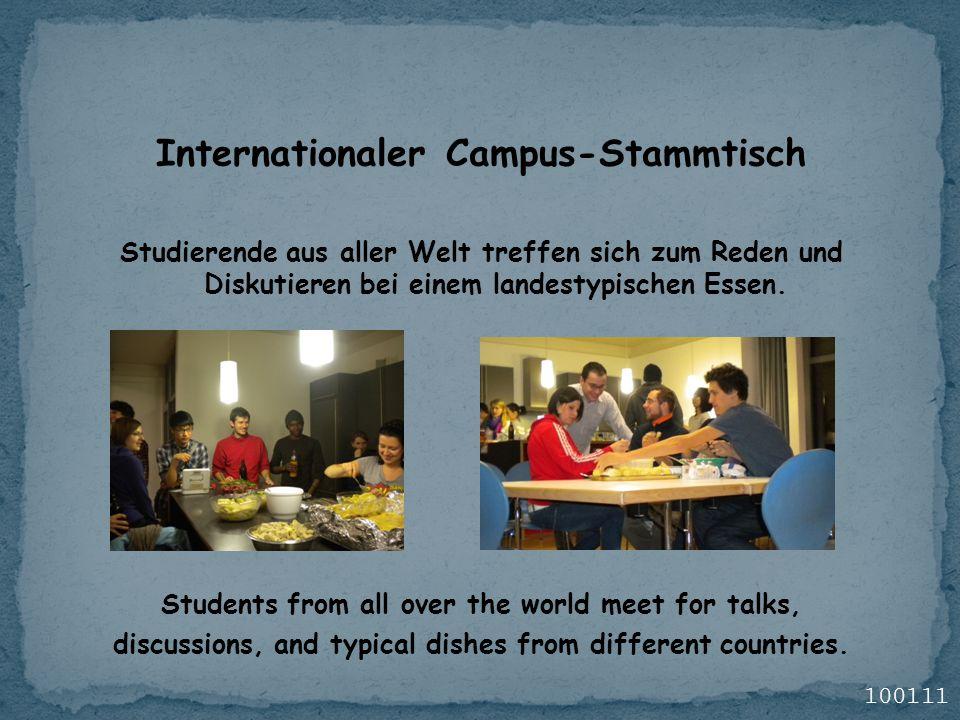 Internationaler Campus-Stammtisch Studierende aus aller Welt treffen sich zum Reden und Diskutieren bei einem landestypischen Essen. Students from all
