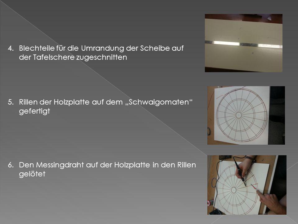 """4.Blechteile für die Umrandung der Scheibe auf der Tafelschere zugeschnitten 5.Rillen der Holzplatte auf dem """"Schwaigomaten gefertigt 6.Den Messingdraht auf der Holzplatte in den Rillen gelötet"""