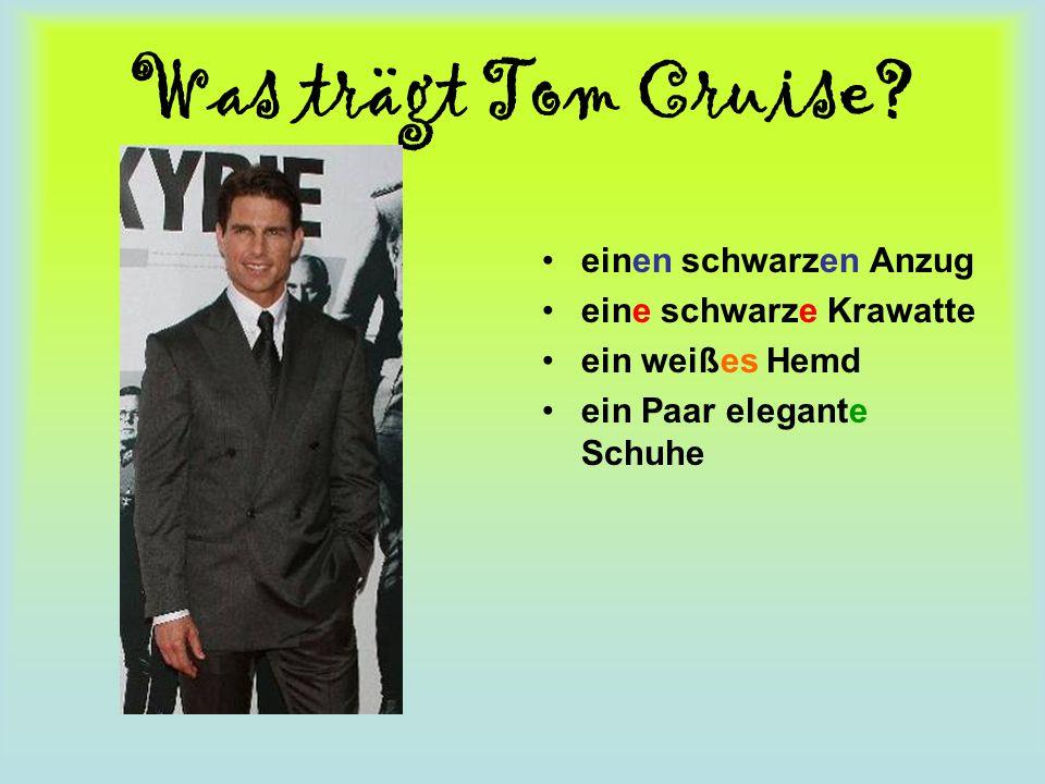 Was trägt Tom Cruise? einen schwarzen Anzug eine schwarze Krawatte ein weißes Hemd ein Paar elegante Schuhe