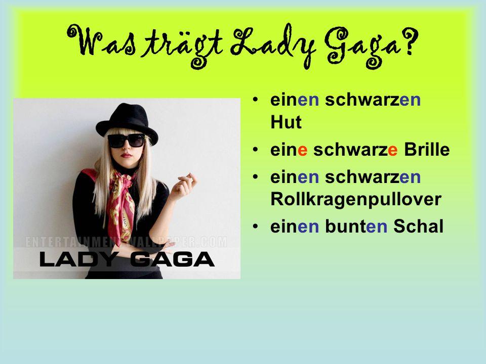 Was trägt Lady Gaga? einen schwarzen Hut eine schwarze Brille einen schwarzen Rollkragenpullover einen bunten Schal