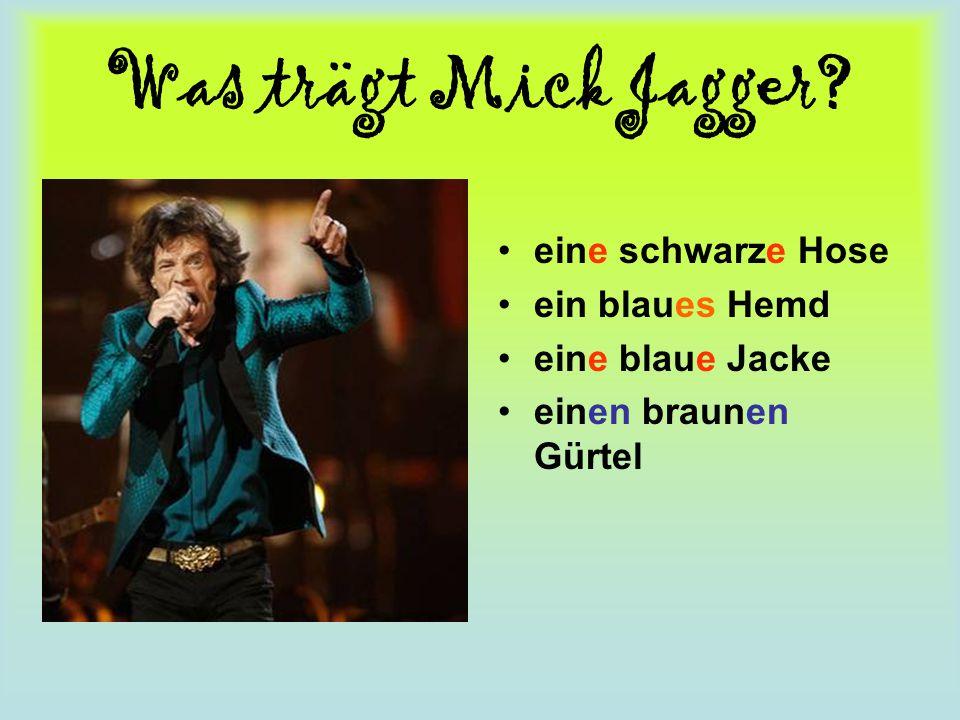 Was trägt Mick Jagger? eine schwarze Hose ein blaues Hemd eine blaue Jacke einen braunen Gürtel