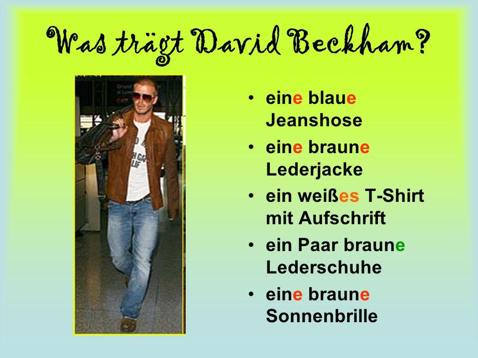 Was trägt David Beckham? eine blaue Jeanshose eine braune Lederjacke ein weißes T-Shirt mit Aufschrift ein Paar braune Lederschuhe eine braune Sonnenb