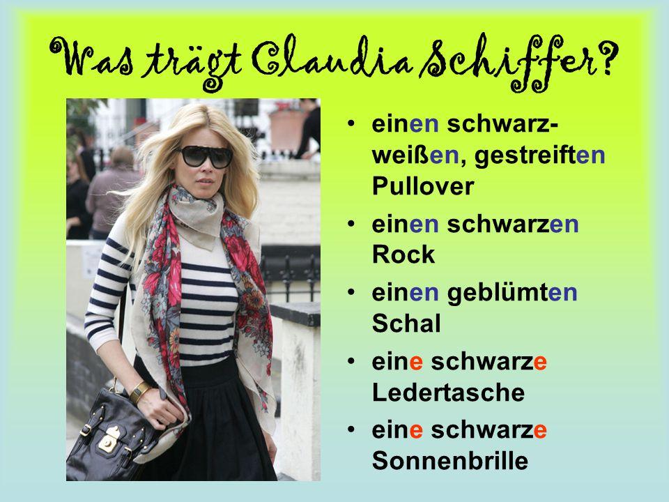 Was trägt Claudia Schiffer? einen schwarz- weißen, gestreiften Pullover einen schwarzen Rock einen geblümten Schal eine schwarze Ledertasche eine schw