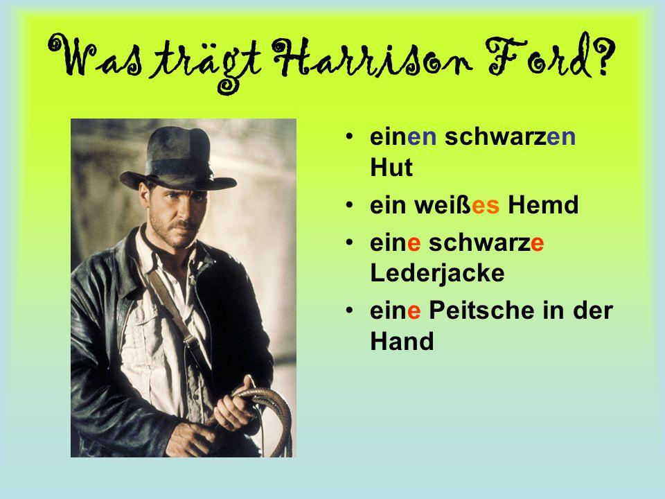 Was trägt Harrison Ford? einen schwarzen Hut ein weißes Hemd eine schwarze Lederjacke eine Peitsche in der Hand