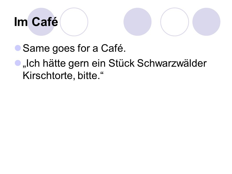 """Im Café Same goes for a Café. """"Ich hätte gern ein Stück Schwarzwälder Kirschtorte, bitte."""