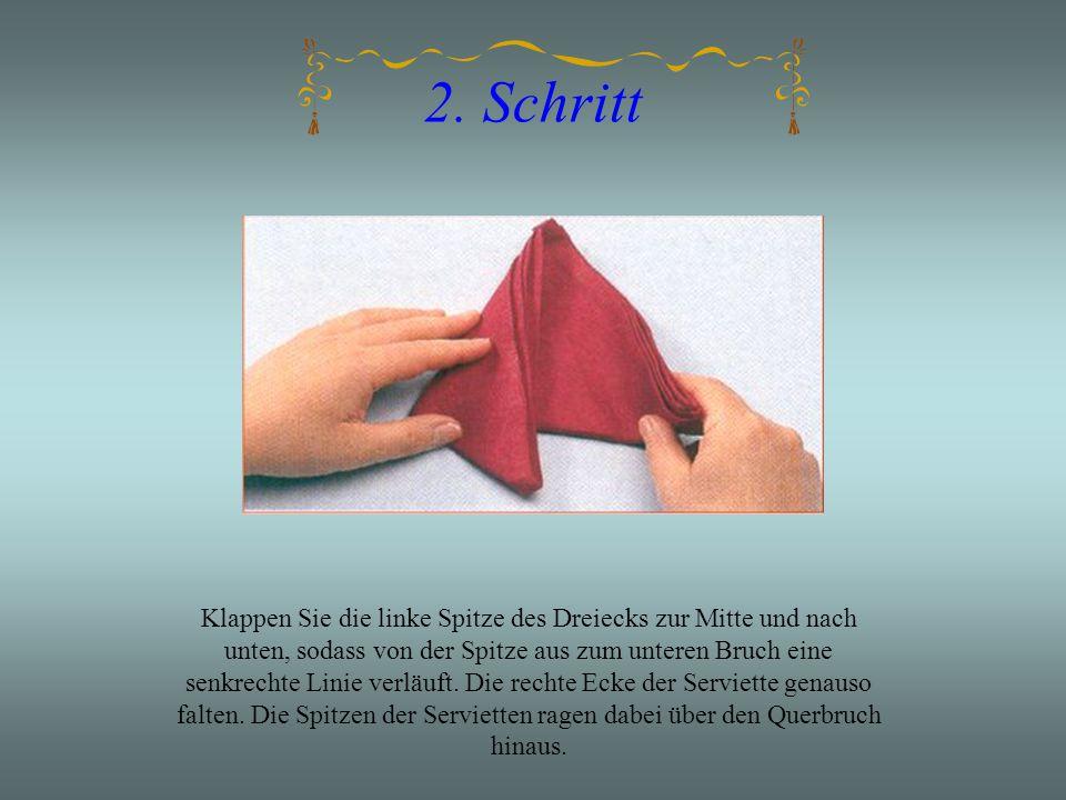 2. Schritt Klappen Sie die linke Spitze des Dreiecks zur Mitte und nach unten, sodass von der Spitze aus zum unteren Bruch eine senkrechte Linie verlä