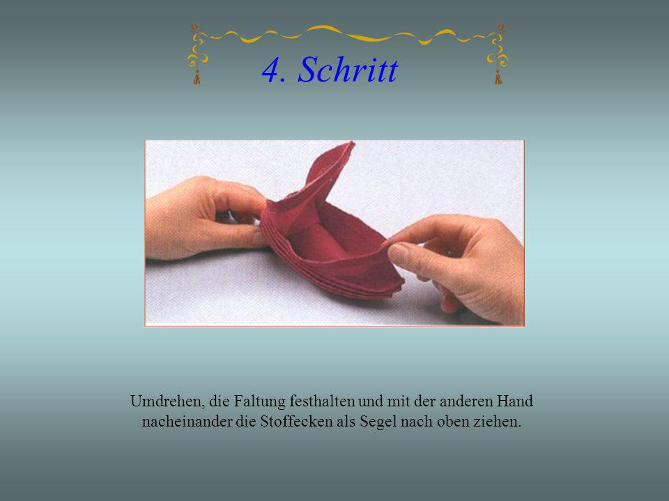 4. Schritt Umdrehen, die Faltung festhalten und mit der anderen Hand nacheinander die Stoffecken als Segel nach oben ziehen.