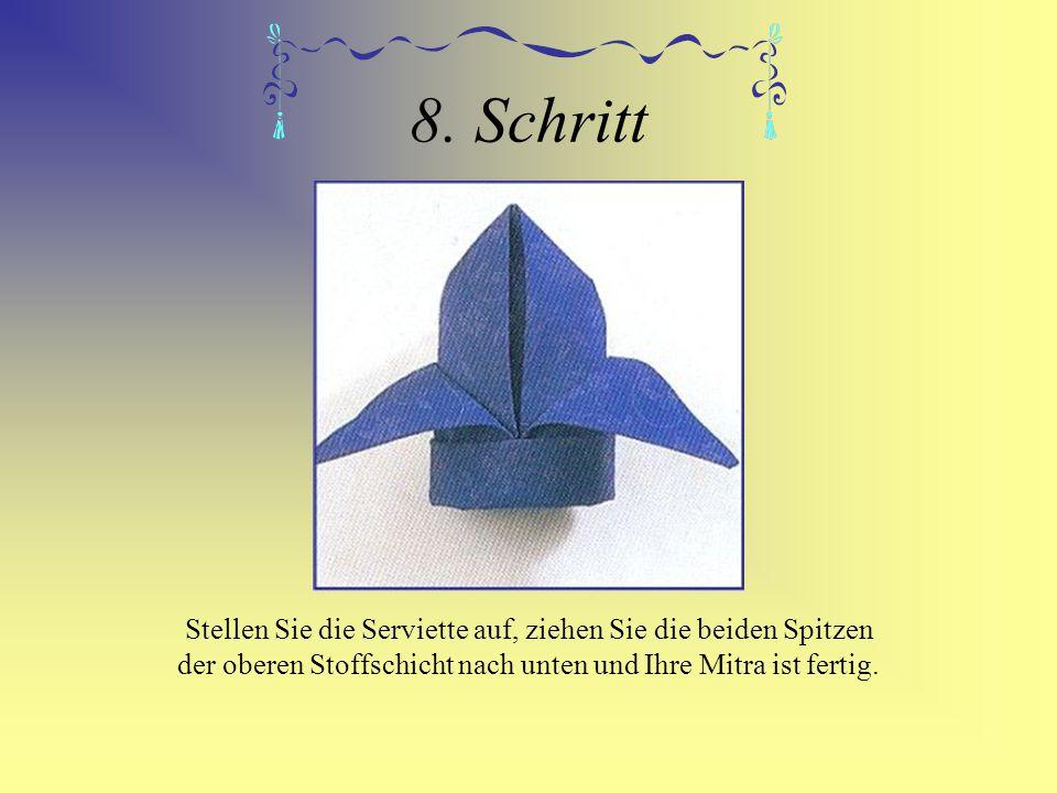 8. Schritt Stellen Sie die Serviette auf, ziehen Sie die beiden Spitzen der oberen Stoffschicht nach unten und Ihre Mitra ist fertig.