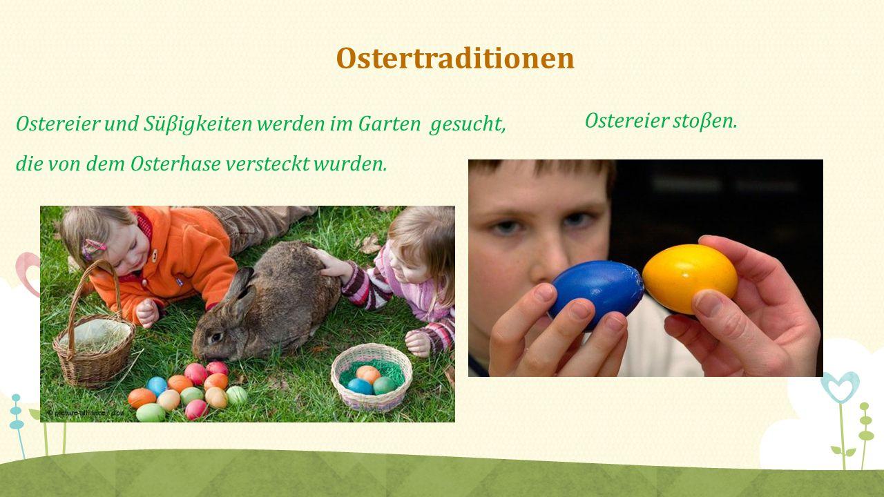 Ostertraditionen Ostereier und Süβigkeiten werden im Garten gesucht, die von dem Osterhase versteckt wurden. Ostereier stoβen.