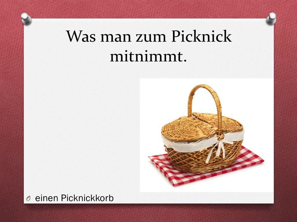 Was man zum Picknick mitnimmt. O einen Picknickkorb