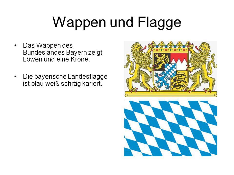 Wappen und Flagge Das Wappen des Bundeslandes Bayern zeigt Löwen und eine Krone. Die bayerische Landesflagge ist blau weiß schräg kariert.