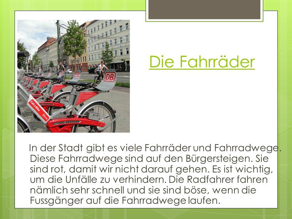 Die Fahrräder In der Stadt gibt es viele Fahrräder und Fahrradwege. Diese Fahrradwege sind auf den Bürgersteigen. Sie sind rot, damit wir nicht darauf