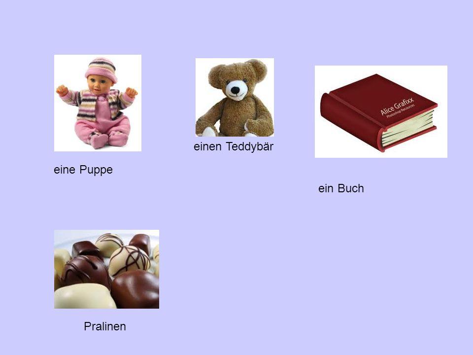 einen Teddybär eine Puppe ein Buch Pralinen