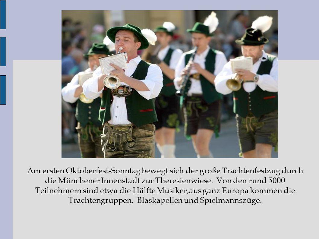 Am ersten Oktoberfest-Sonntag bewegt sich der große Trachtenfestzug durch die Münchener Innenstadt zur Theresienwiese. Von den rund 5000 Teilnehmern s