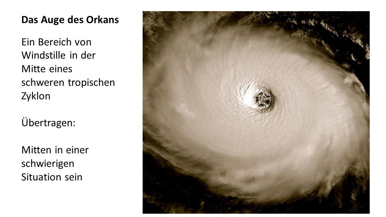 Das Auge des Orkans Ein Bereich von Windstille in der Mitte eines schweren tropischen Zyklon Übertragen: Mitten in einer schwierigen Situation sein