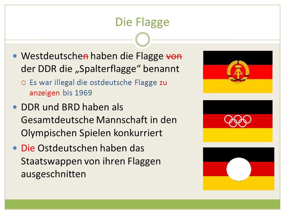 """Die Flagge Westdeutschen haben die Flagge von der DDR die """"Spalterflagge benannt  Es war illegal die ostdeutsche Flagge zu anzeigen bis 1969 DDR und BRD haben als Gesamtdeutsche Mannschaft in den Olympischen Spielen konkurriert Die Ostdeutschen haben das Staatswappen von ihren Flaggen ausgeschnitten"""