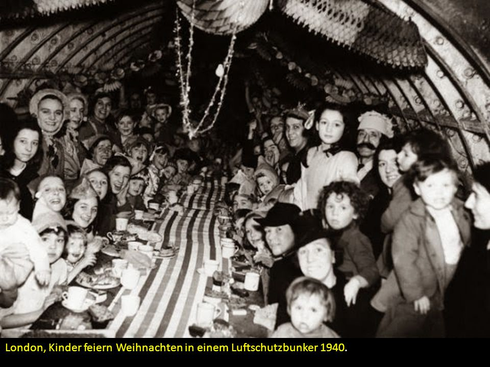 London, Kinder feiern Weihnachten in einem Luftschutzbunker 1940.