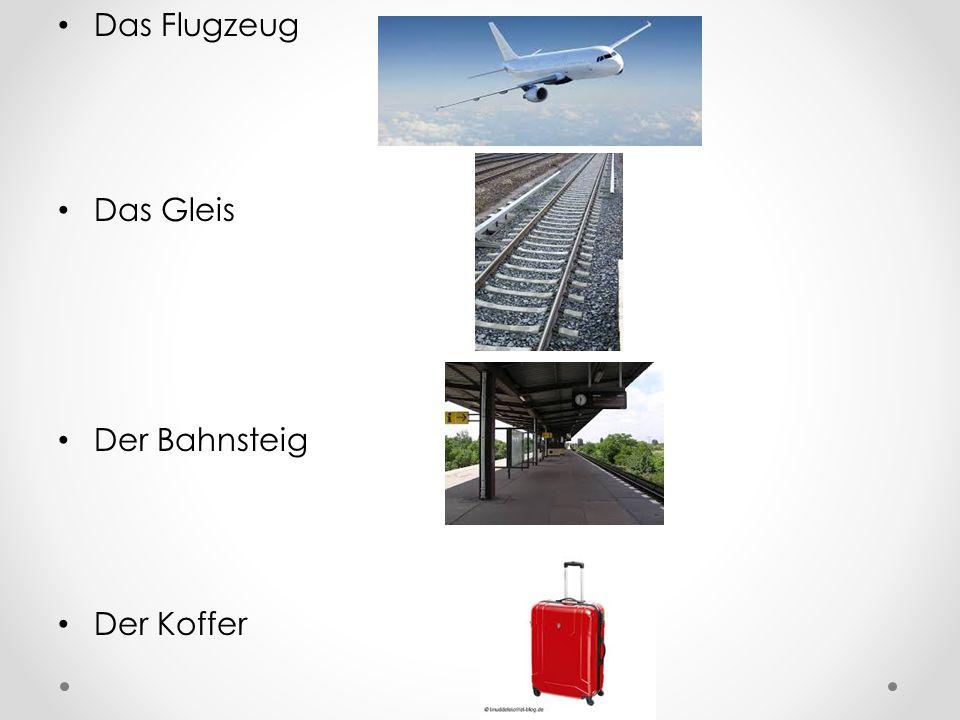 Das Flugzeug Das Gleis Der Bahnsteig Der Koffer