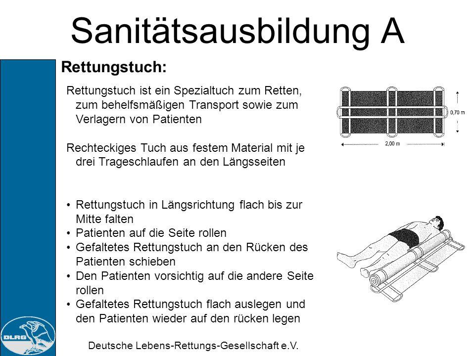 Deutsche Lebens-Rettungs-Gesellschaft e.V. Sanitätsausbildung A Schultertrage nach Rautek: Helfer tritt mit dem rechten Bein auf den an ein Wand / Bau