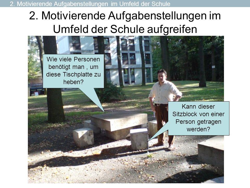 2. Motivierende Aufgabenstellungen im Umfeld der Schule aufgreifen Kann dieser Sitzblock von einer Person getragen werden? Wie viele Personen benötigt
