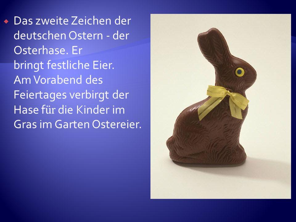 Das zweite Zeichen der deutschen Ostern - der Osterhase. Er bringt festliche Eier. Am Vorabend des Feiertages verbirgt der Hase f ür die Kinder im Gra