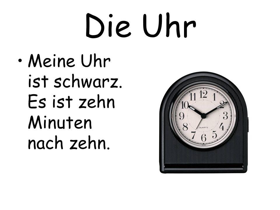 Die Uhr Meine Uhr ist schwarz. Es ist zehn Minuten nach zehn.