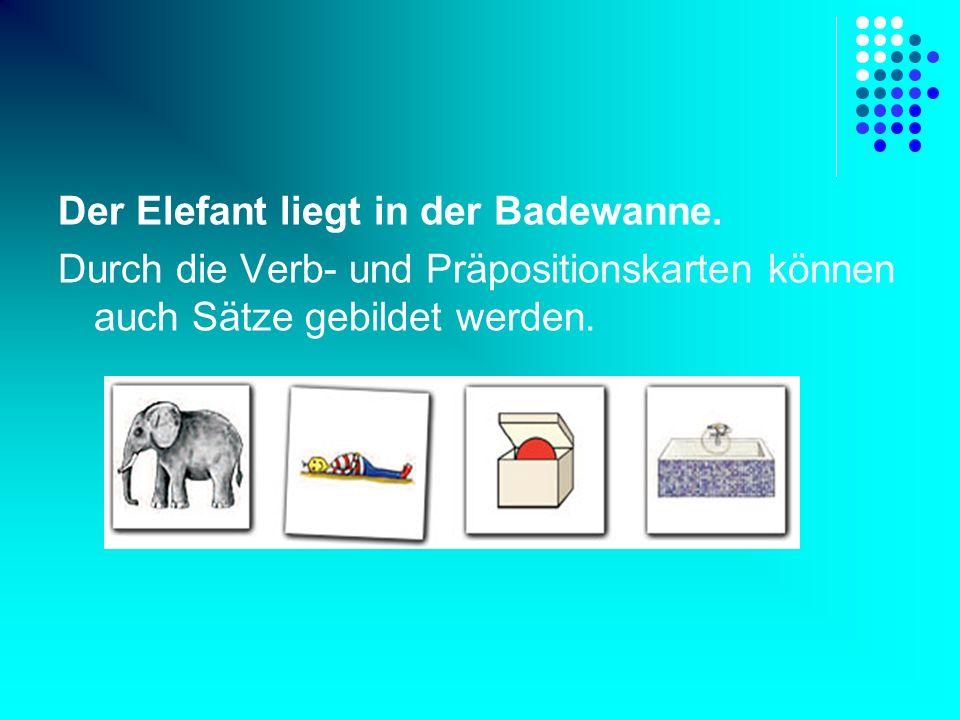 Der Elefant liegt in der Badewanne. Durch die Verb- und Präpositionskarten können auch Sätze gebildet werden.