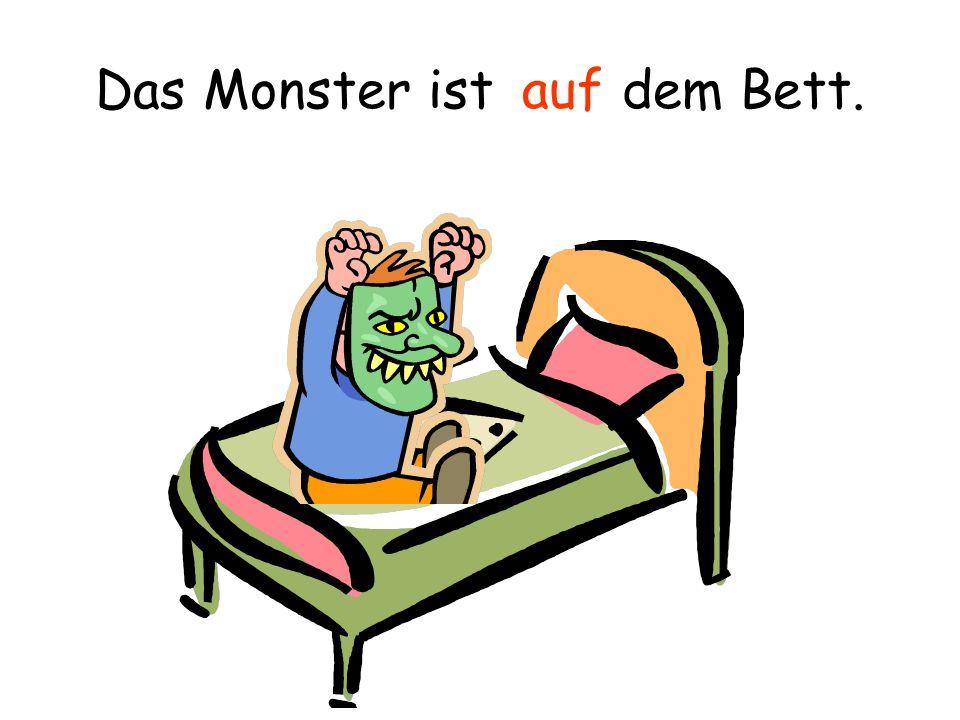 Ein Bild von dem Monster ist der Wand. an