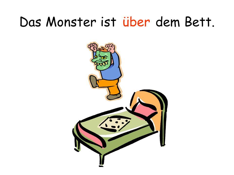 Das Monster ist dem Bett. unter