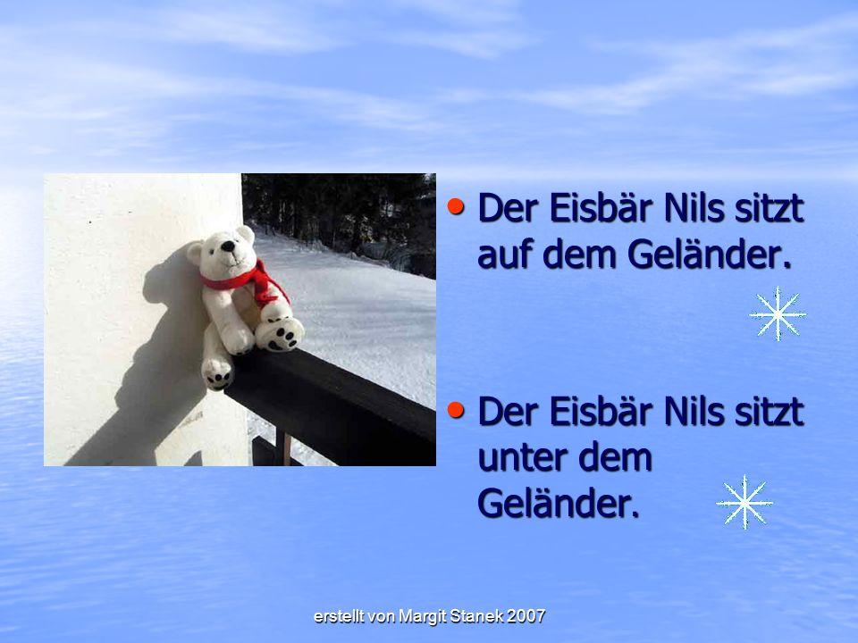 erstellt von Margit Stanek 2007 Der Eisbär Nils sitzt auf dem Geländer.