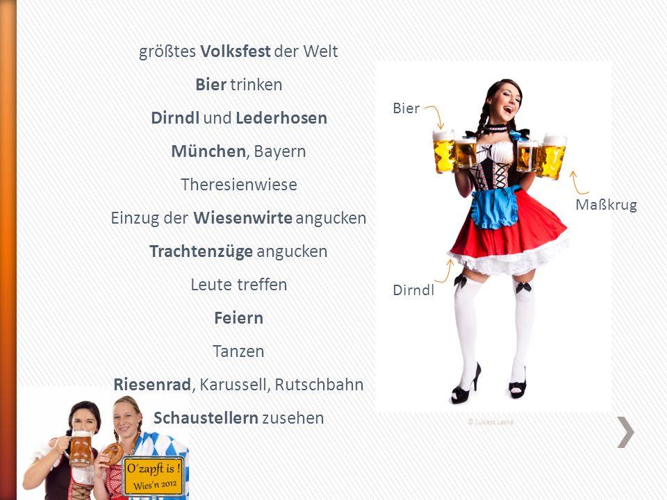 Bier Maßkrug Dirndl © Lukasz Laska größtes Volksfest der Welt Bier trinken Dirndl und Lederhosen München, Bayern Theresienwiese Einzug der Wiesenwirte