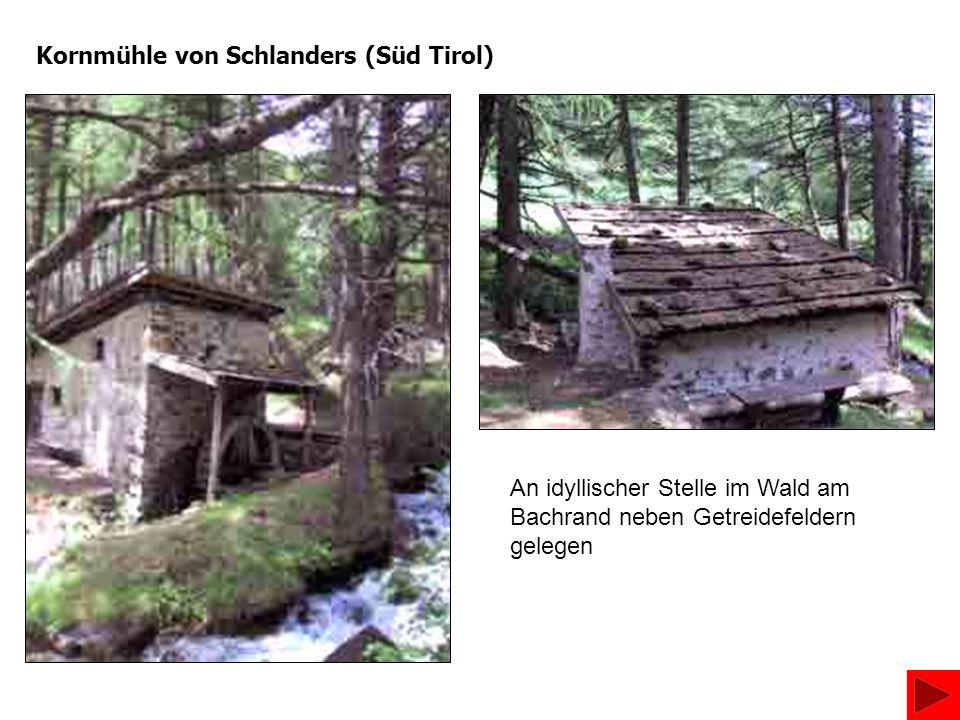 Kornmühle von Schlanders (Süd Tirol) An idyllischer Stelle im Wald am Bachrand neben Getreidefeldern gelegen