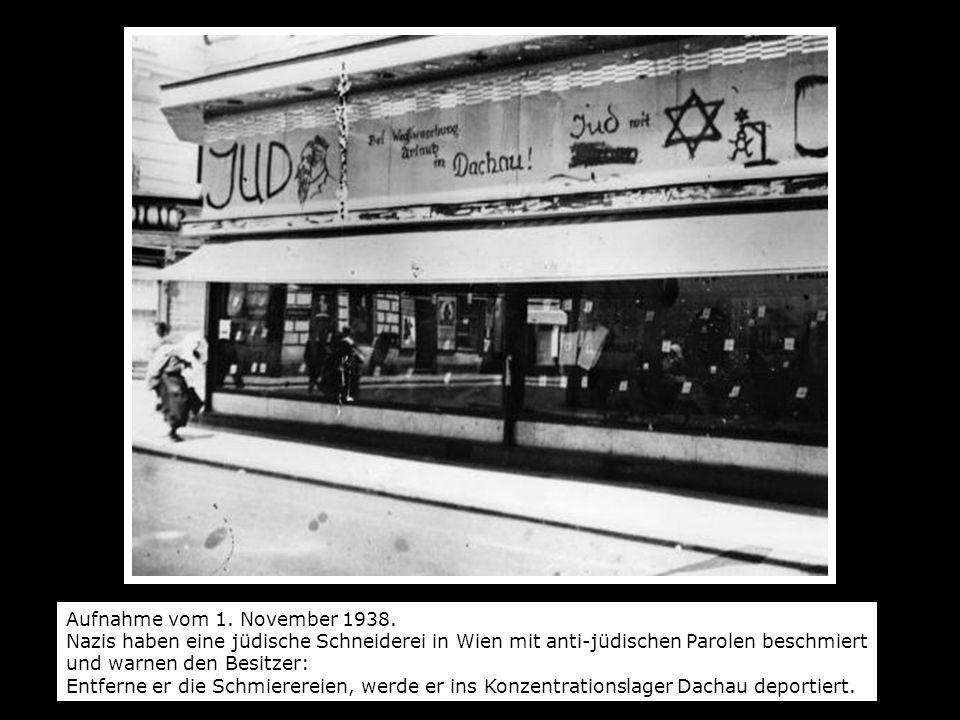 Aufnahme vom 1. November 1938. Nazis haben eine jüdische Schneiderei in Wien mit anti-jüdischen Parolen beschmiert und warnen den Besitzer: Entferne e