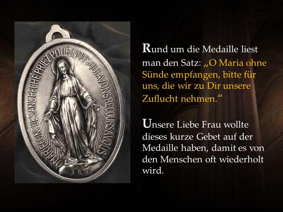 R und um die Medaille liest man den Satz: O Maria ohne Sünde empfangen, bitte für uns, die wir zu Dir unsere Zuflucht nehmen.