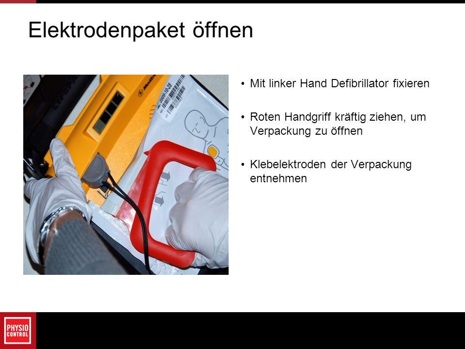 Elektrodenpaket öffnen Mit linker Hand Defibrillator fixieren Roten Handgriff kräftig ziehen, um Verpackung zu öffnen Klebelektroden der Verpackung en