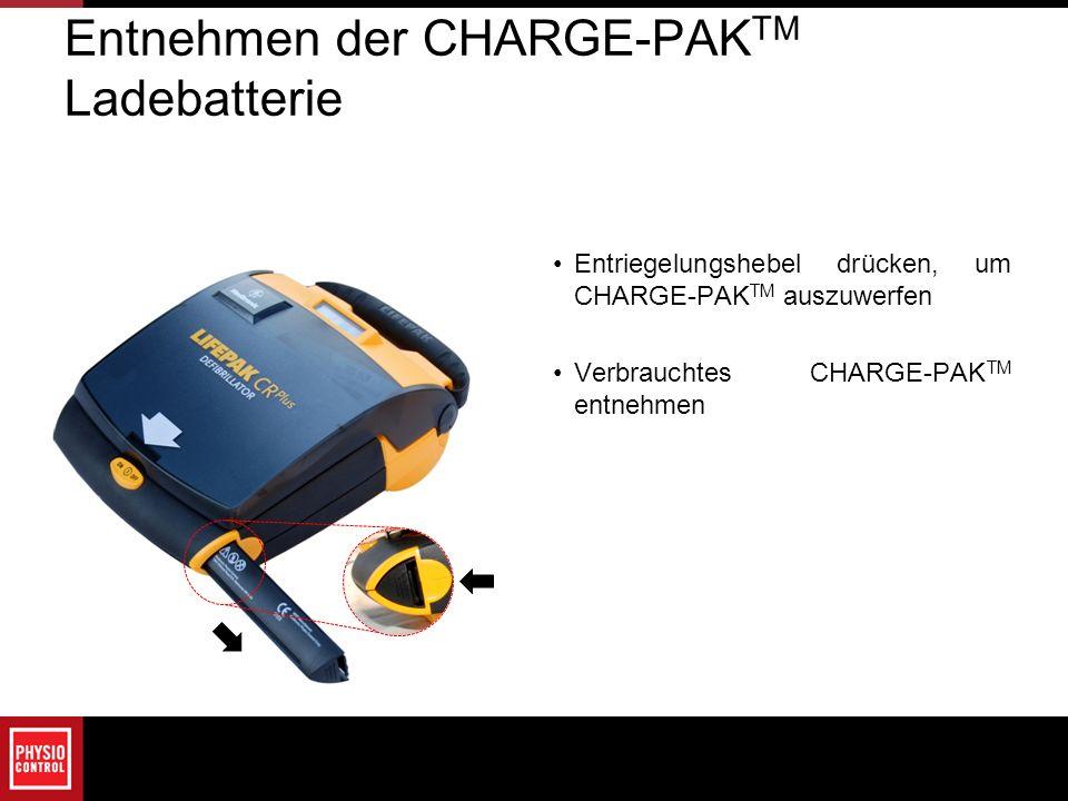 Entnehmen der CHARGE-PAK TM Ladebatterie Entriegelungshebel drücken, um CHARGE-PAK TM auszuwerfen Verbrauchtes CHARGE-PAK TM entnehmen