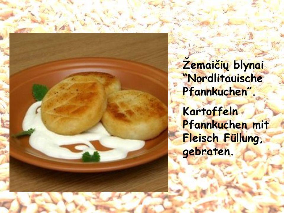 Žemaičių blynaiNordlitauische Pfannkuchen. Kartoffeln Pfannkuchen mit Fleisch Füllung, gebraten.
