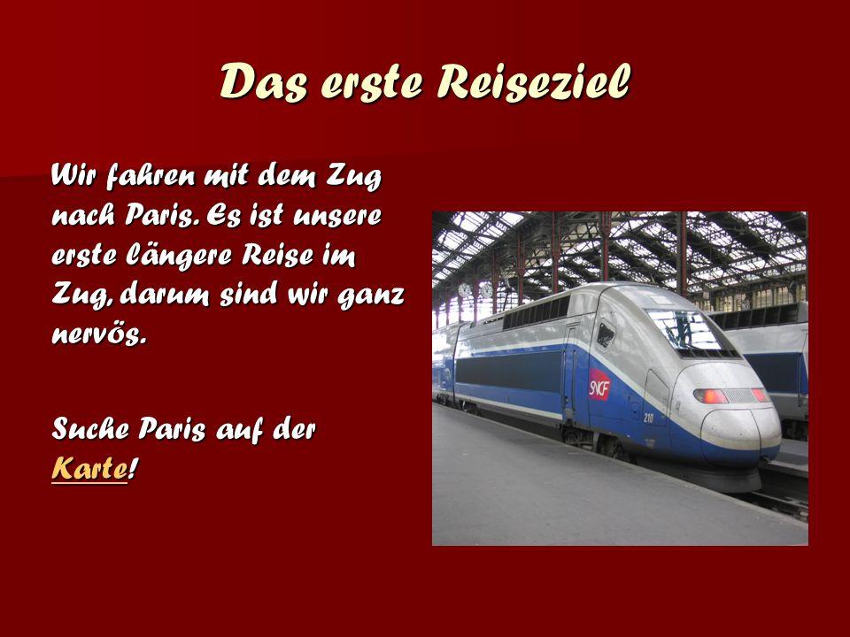 Wir fahren mit dem Zug nach Paris.