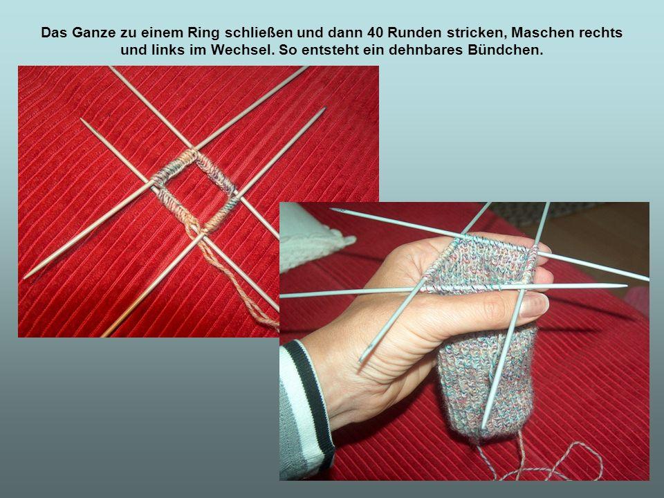 Jetzt geht es an die Vorbereitung zur Ferse: Die Maschen müssen auf 2 Nadeln verteilt werden, (Je 30) und zwar die einen 30 von Nadel 1 und 4 und die anderen 30 von Nadel 2 und 3.