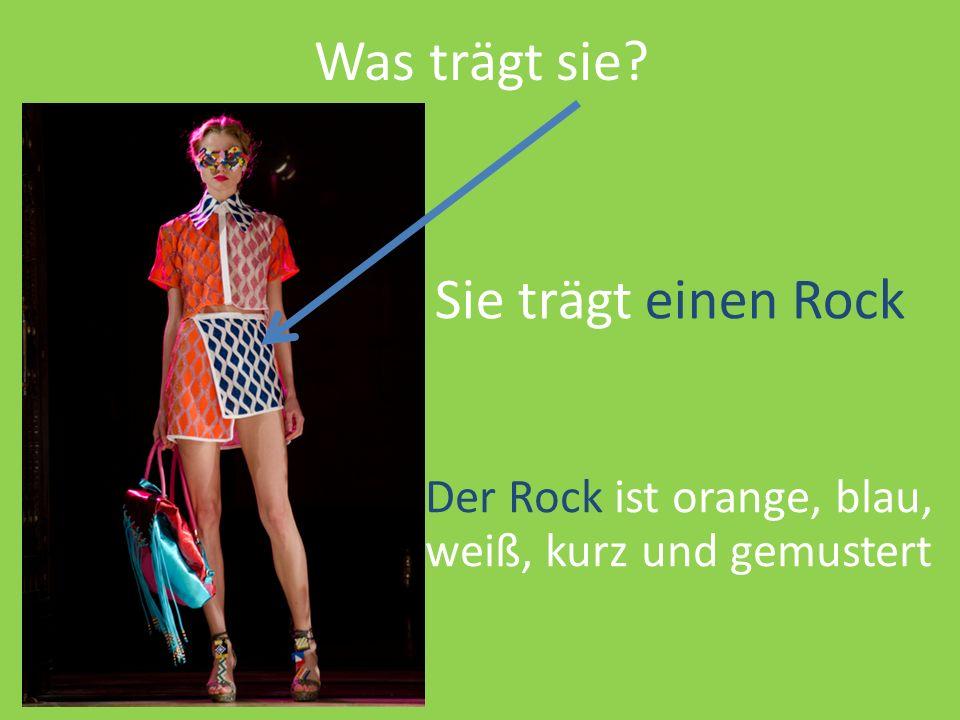 Was trägt sie? Sie trägt einen Rock Der Rock ist orange, blau, weiß, kurz und gemustert