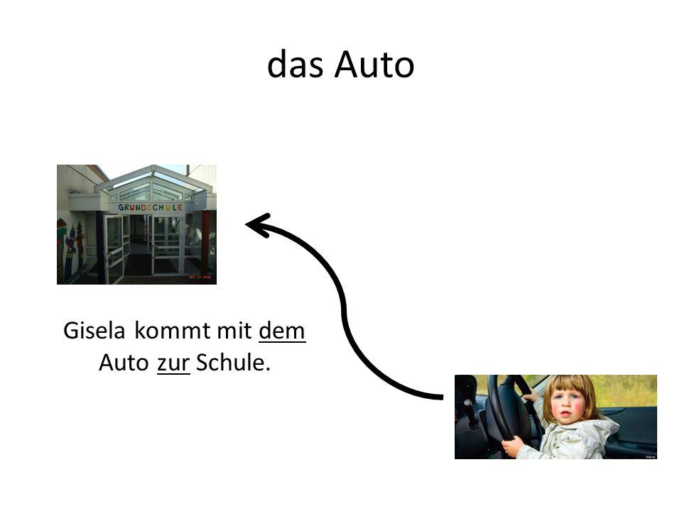 das Auto Gisela kommt mit dem Auto zur Schule.