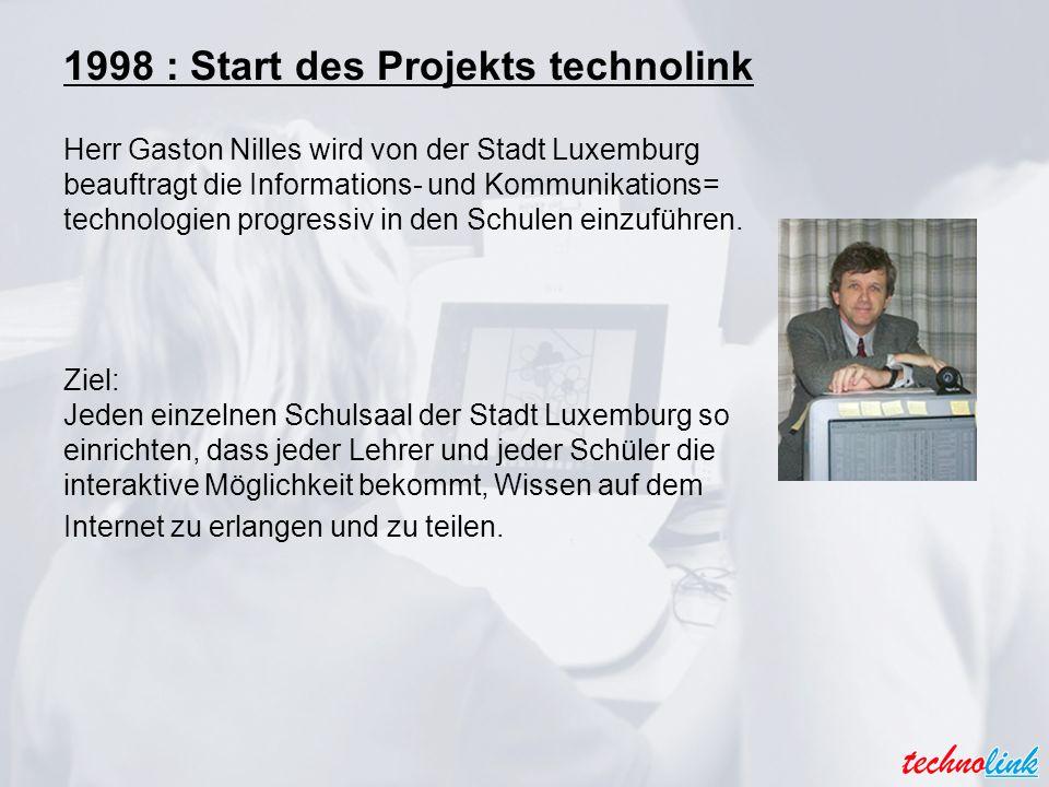 1998 : Start des Projekts technolink Herr Gaston Nilles wird von der Stadt Luxemburg beauftragt die Informations- und Kommunikations= technologien progressiv in den Schulen einzuführen.