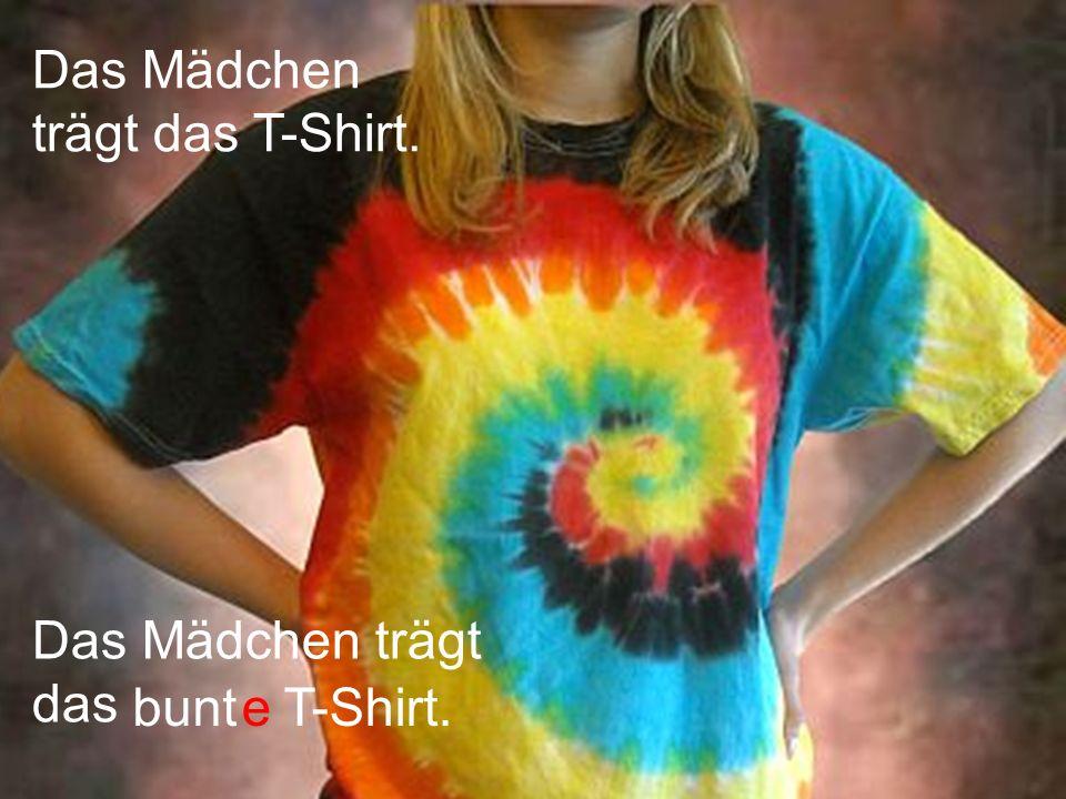Das Mädchen trägt das T-Shirt. Das Mädchen trägt das bunteT-Shirt.