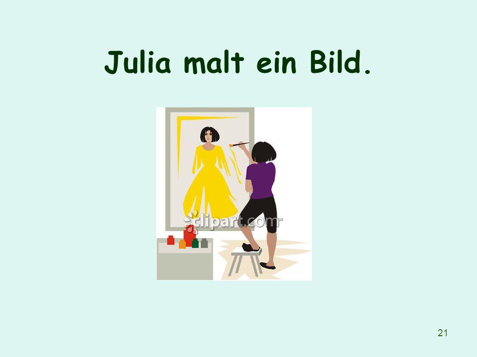 21 Julia malt ein Bild.